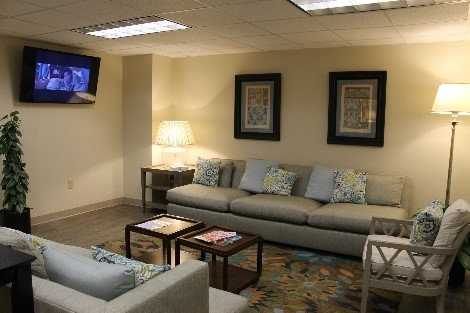 Waiting room with couches and TV