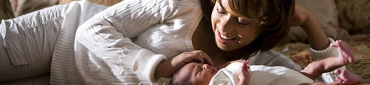 Woman smiling at infant