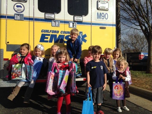 Children in front of EMS vehicle
