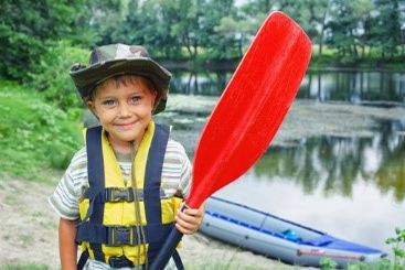 Child holding paddle