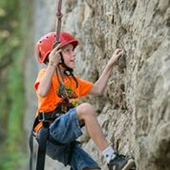 Child climbing rock face