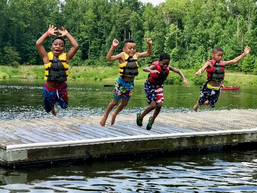 Kids jumping off dock