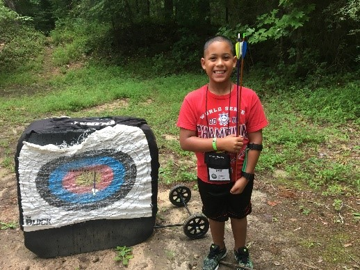 Child with archery equipment